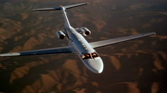 Cessna Citation CJ3 Air to Air Fly Over Left Stock Footage