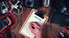 """4k Technology Composition from Above of Hand writing """"Work"""" Stock Footage"""