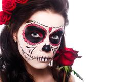Day of the dead. Halloween. Young woman in day of the dead mask skull face art Stock Photos