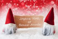 Red Christmassy Gnomes With Card, Bonne Annee Means New Year Stock Photos