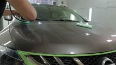 Worker polishing a car Stock Footage