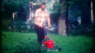 African American man cuts the grass at his home, 3666 vintage film home movie Stock Footage