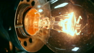 Electric Bulb Lamp. Bright ideas. Real Light Bulb Turning On Stock Footage