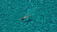 Aerial - Young woman in white bikini swimming underwater in crystal clear water Stock Footage