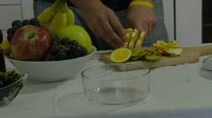 Preparing a fruit salat Stock Footage