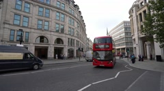 London Buses at St Pauls Churchyard in the city of London Stock Footage
