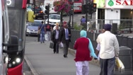 Street traffic and Indian people in Londons suburb Southall Stock Footage