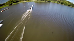 Aerial drone shot of a man riding his wakeboard at a cable park. Stock Footage