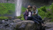 Friends Pose For Selfies On A Rock Under A Waterfall Stock Footage