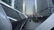 Pedestrian bridge between Crossrail and One Canada building at Canary Wharf Stock Footage
