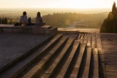 Young people admiring landscape at sunset, Military Memorial of Redipuglia Stock Photos