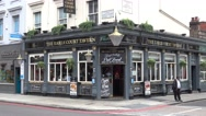 Typical English Pub or Irish pub at Earls Court London Stock Footage
