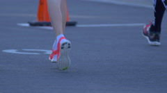 Detail of legs of people running in a 10K race. Stock Footage
