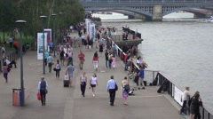 Crowdy banks of River Thames in London Stock Footage