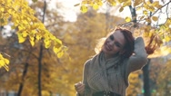 Happiness carefree leisure concept. Redhaired long hair woman relaxing in autumn Stock Footage