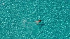Aerial - Beautiful young woman in white bikini swimming underwater Stock Footage