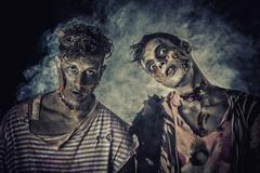 Two male zombies standing on black smoky background Kuvituskuvat