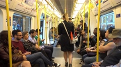 People travelling with London Underground Stock Footage