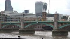Southwark Bridge over River Thames in London Stock Footage