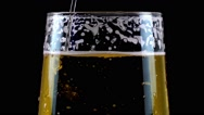 Pouring Beer on Black Background Stock Footage