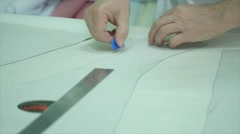 Seamstress prepares materials for cutting Stock Footage
