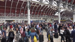 Passengers waiting at Paddington Station in London Stock Footage