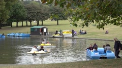 People enjoying the last days of summer at Geenwich Park Stock Footage