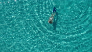 Aerial - Young woman snorkeling underwater in crystal clear waters Stock Footage
