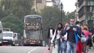 Street traffic and tourists on Westminster Bridge in London Stock Footage