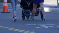 The back of a crowd of people running in a 10K race. Stock Footage