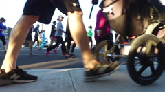 A crowd of people running in a 10K race. Stock Footage