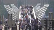 Lots of tourists on Millennium Bridge in London Stock Footage