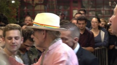 Actor Ian McKellen writing autographs at theater in London Stock Footage