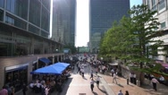 Reuters Square at Canary Wharf on a sunny day Stock Footage