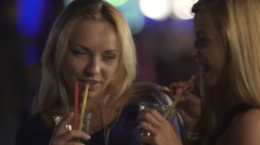 Flirty seductive women drinking cocktails, dancing and hugging in night club Stock Footage