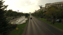 Aerial view of a boulevard with fountains in modern city skyline Stock Footage