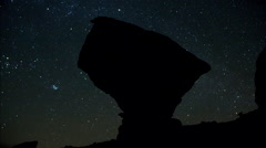 Time-lapse of stars and a balanced bolder rock. Stock Footage