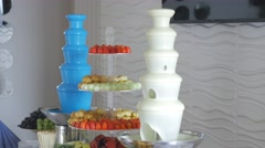 Dessert table with chocolate machine fountain Stock Footage