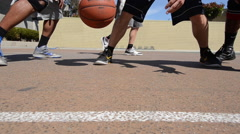 Detail tracking shot of shoes and footwork of men playing two-on-two pick up bas Stock Footage
