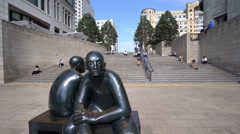 Statue of two sitting men at Cubitt Steps - London Canary Wharf Stock Footage
