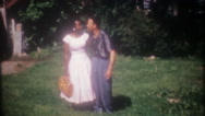 African American couple kiss and hug each other, 3670 vintage home movie Stock Footage