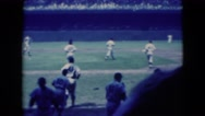 1949: rugby players are running into the playground to start the game MIDDLETOWN Stock Footage
