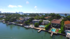 Aerial tour homes of the rich and famous Miami Beach Stock Footage