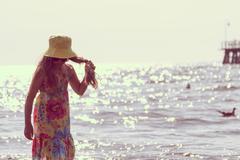 Little girl kid walking on beach at sea. Fun. Stock Photos