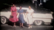 New Cadillac in the neighborhood attracts a crowd, 3671 vintage film home movie Stock Footage