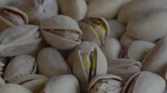 Pistachio Scattered Pistachio Nuts on a rotating plate Stock Footage