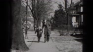 1949: father is seen playing with children MIDDLETOWN Stock Footage