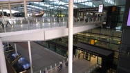 Footbridges to Arrival and Departure gates at London Heathrow Airport Stock Footage