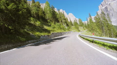 Cyclists climbing up the scenic Sella Pass in Italian Alps Stock Footage