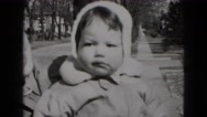 1949: mother holding child posing for the camera  Stock Footage